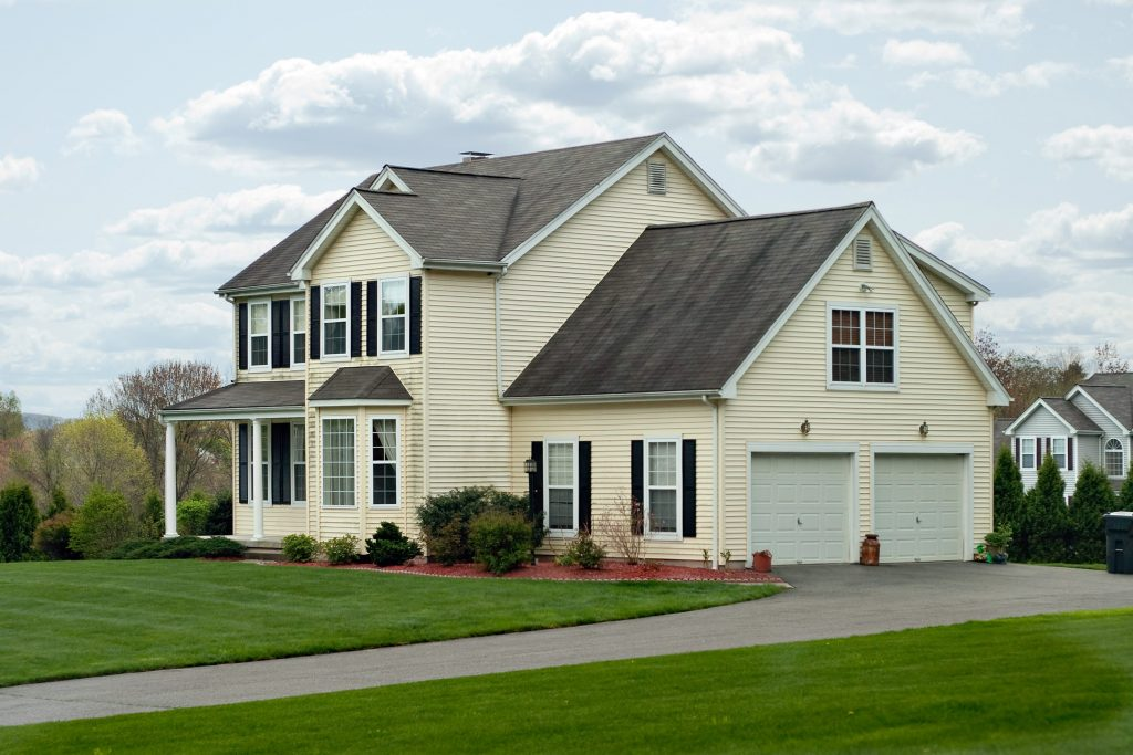 modern home with asphalt driveway
